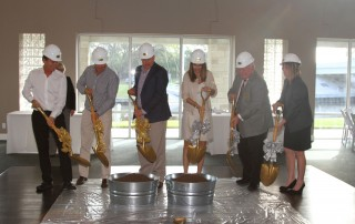 6 workers from Sabal Palms breaking ground with gold shovels and hard hats