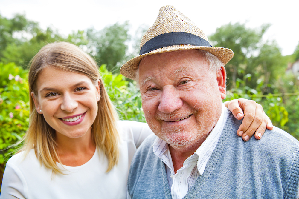 senior man and daughter outside