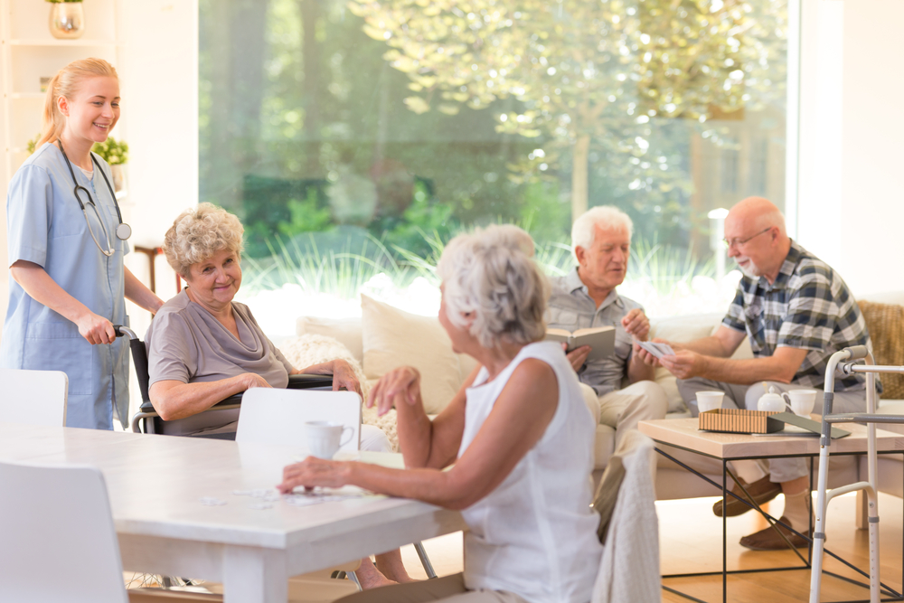 seniors gathered together in senior living facility