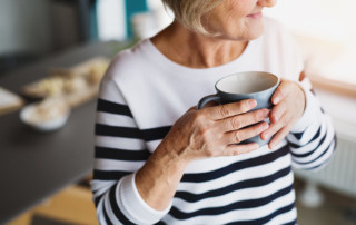 Sabal-Palms-senior-woman-drinking-tea-coffee-holding-mug