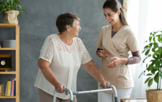 Sabal Palms Senior Living and Memory Care Senior woman talking to nurse caregiver