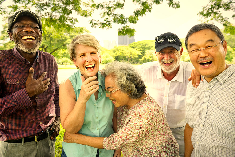 Group of 5 seniors, men and women, laughing and smiling