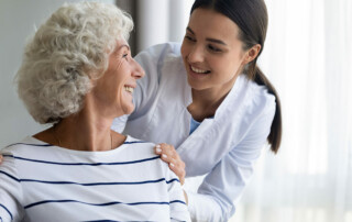 Senior woman with Alzheimer's talking with memory care nurse