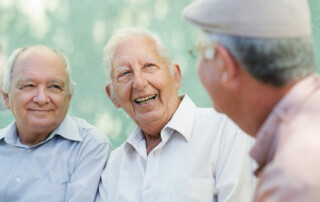 Senior men sitting and talking, socializing, at assisting living community