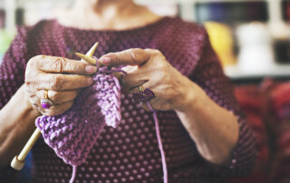 Close up of senior woman's hands knitting