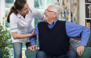 Senior man with nurse, caregiver in assisted living