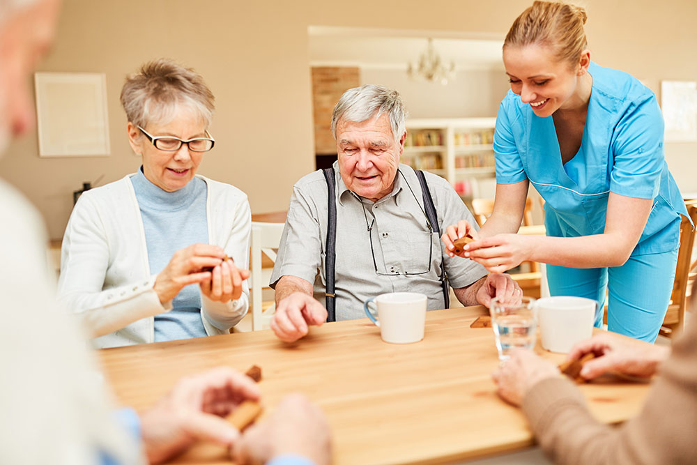 Seniors playing games in assisted living