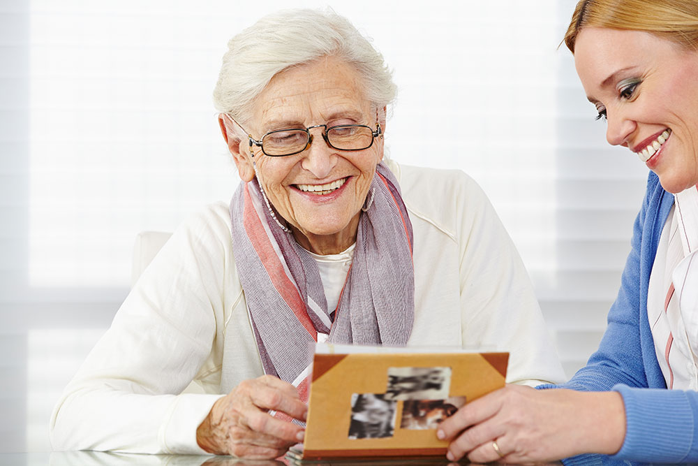 Senior woman with caregiver in Alzheimer's assisted living